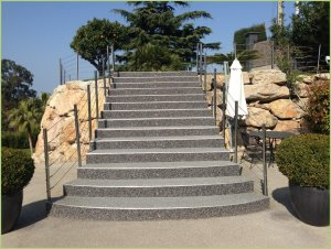 An exterior staircase in marble aggregate